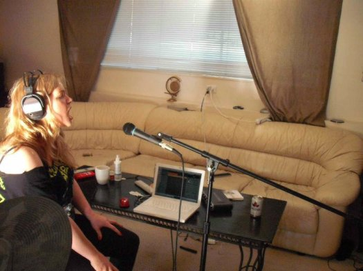 Recording vocals with his sister Emily.